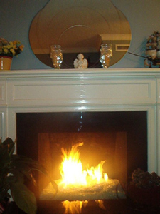 custom fireplace with fire burning glass stones