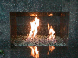 marble fireplace design using fire glass rocks