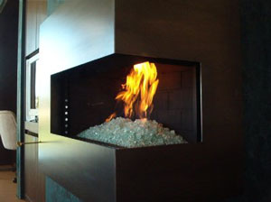 corner fireplace with burning glass