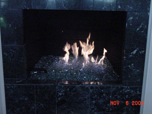 custom fireplace with fire glass rocks