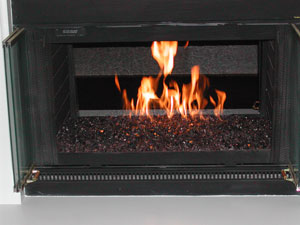 fireplace with bronze fireglass